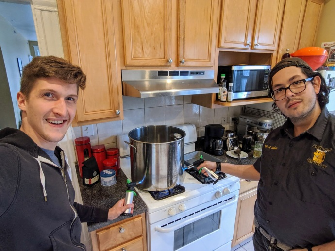 Dariusz and Nick heating a brew kettle with brulee torches
